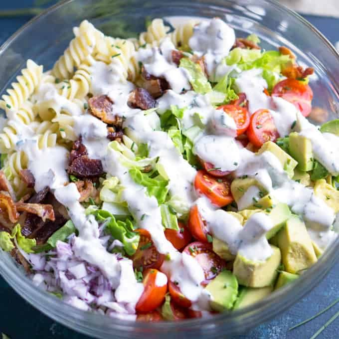 Bacon meets healthy in this BLT pasta salad with avocado and Greek yogurt ranch! #blt #bacon #ranch #greekyogurt #salad #bbq #laborday #memorialday #4thofjuly #summersalad #avocado