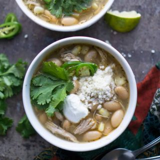 Throw-and-go (NO precook) crockpot recipe with JUICY chicken results! Easy Slow Cooker White Chicken Chili for busy weeknights! thekitchengirl.com #slowcookerchili #crockpotchili #whitechickenchili #slowcooker #crockpot #chili #whitechili #glutenfree #cincodemayo #mexicanchili