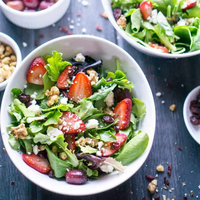 Strawberries, feta, candied walnuts, grapes, and dried cranberries make Strawberry Spring Salad a thirst quencher! #strawberryrecipe #strawberrysalad #candiedwalnuts #springsalad #springmix #strawberries #candiedwalnuts