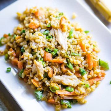 Teriyaki Chicken Fried Rice on white plate with bamboo utensil and white napkin
