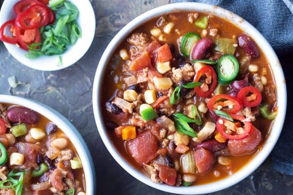 Extra lean turkey chili recipe LOADED with vegetables and three beans. #glutenfree #chili #healthychili #turkeychili #gameday #tailgatefood #mealprep
