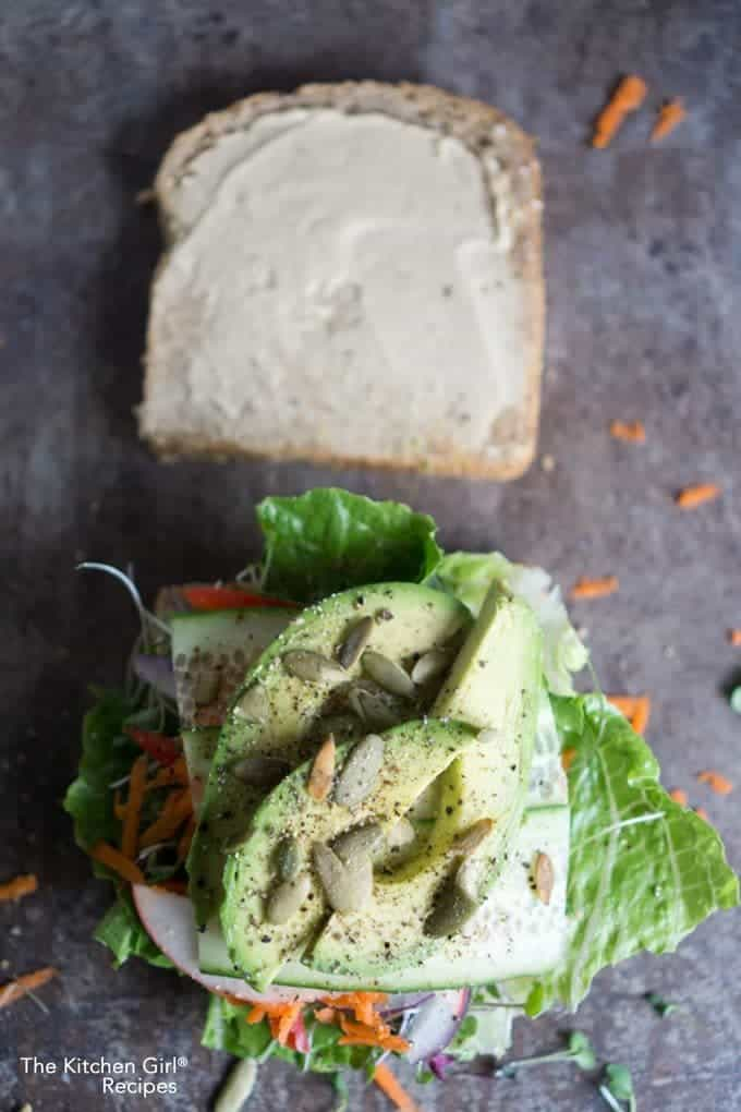 veggie sandwich piled up and served open faced