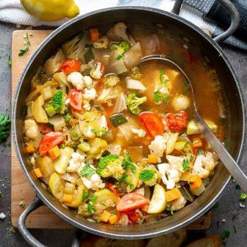 pot of vegan soup with fresh vegetables