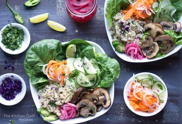 banh mi bowl consiting of colorful vegetables and grain in white bowl