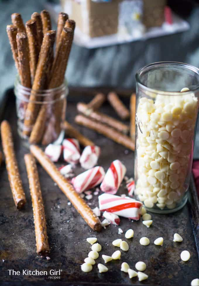 Skip the candy coating and use vanilla milk chocolate! Soooo addicting and easy to make! White Chocolate Peppermint Bark Christmas Pretzel Rods #whitechocolate #holidaycandy #peppermintbark #christmasbark #peppermintbarkpretzels