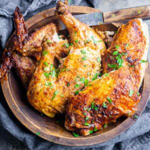 air fryer whole chicken cut into pieces in wood serving bowl