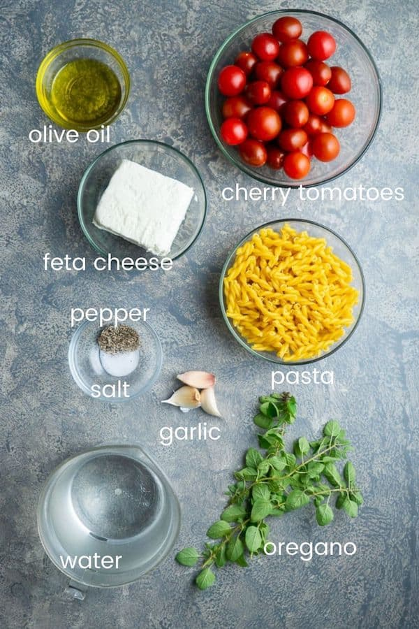 baked feta pasta recipe ingredients in glass bowls with text overlay
