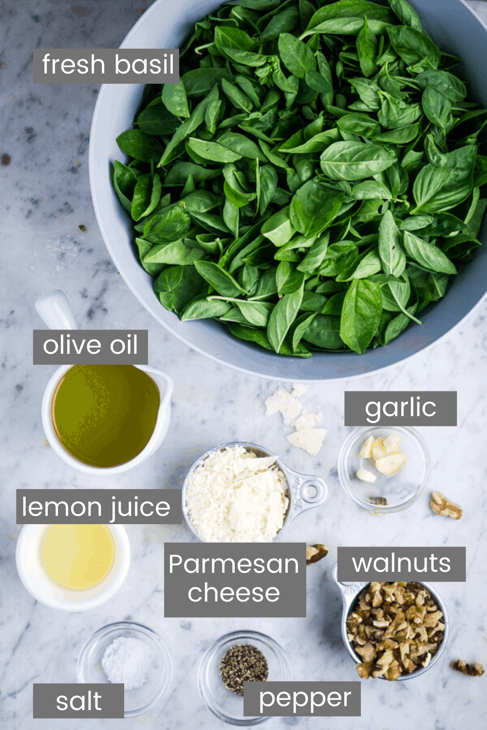 basil pesto ingredients in glass bowls with text overlay