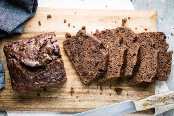 sliced chocolate banana bread laying on cutting board