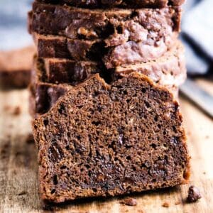 slice of chocolate banana bread leaning against stacked sliced