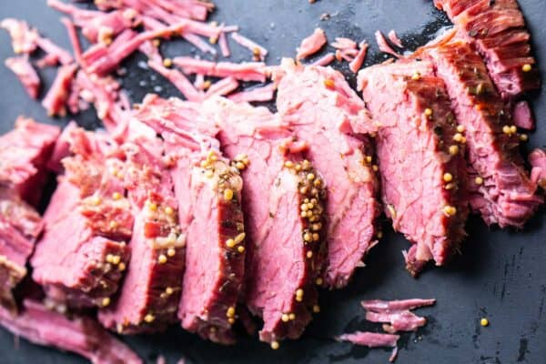 sliced corned beef on cutting board