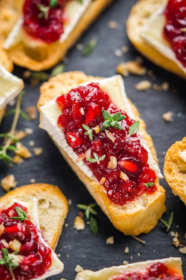 crostini with brie and cranberry sauce on tray