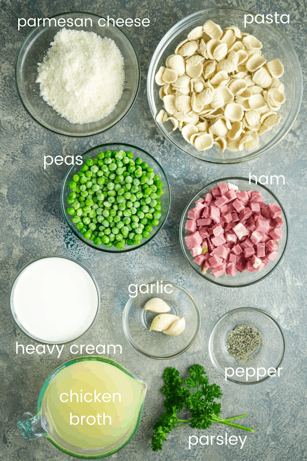 ham and peas alfredo pasta ingredients in individual glass bowls labeled with text overlay