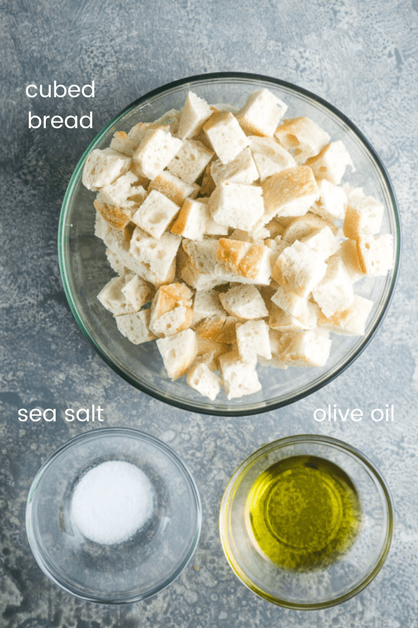 homemade crouton ingredients in individual glass bowls labeled with text overlay