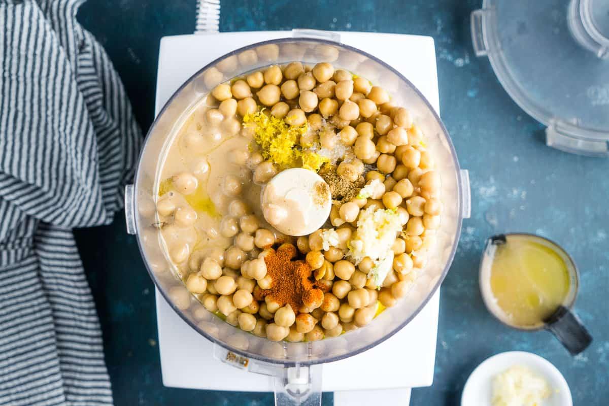 unmixed hummus ingredients in food processor