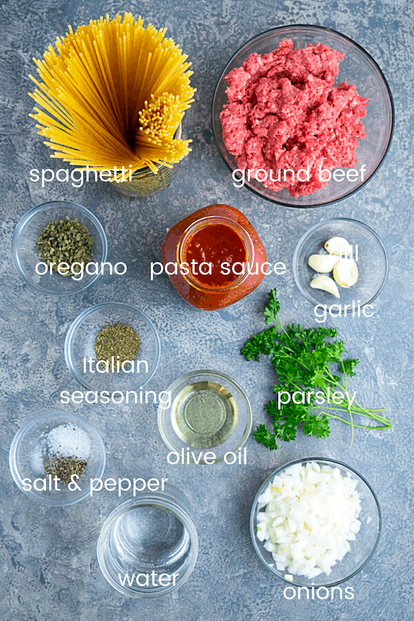 instant pot spaghetti ingredients in glass bowls with text overlay