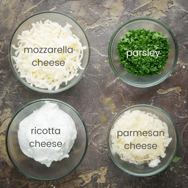 3 cheeses and chopped parsley occupying 4 individual glass bowls