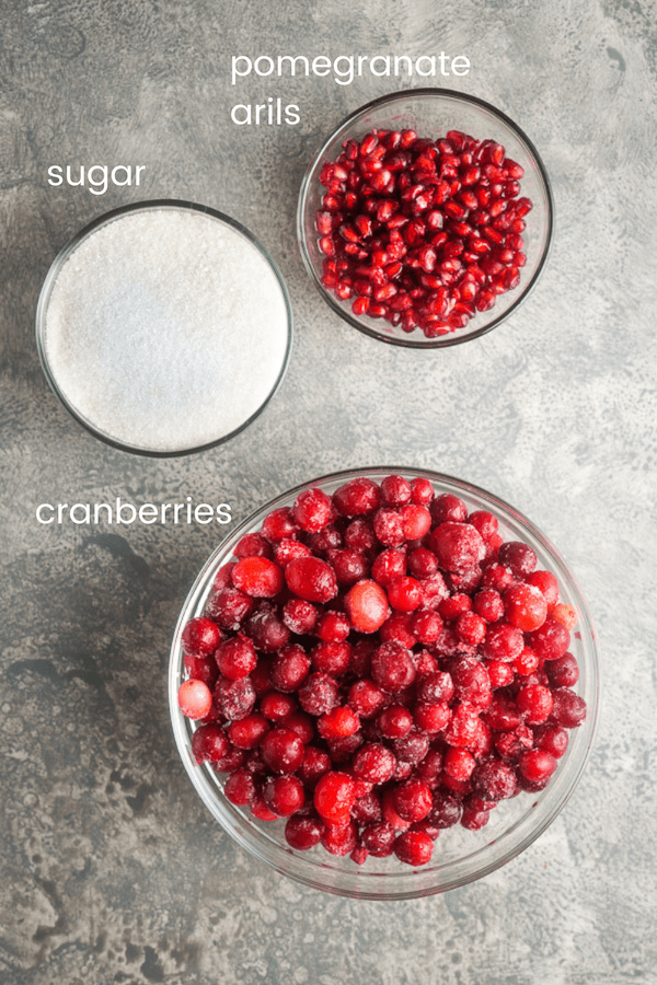pomegranate cranberry relish ingredients in individual glass bowls labeled with text overlay