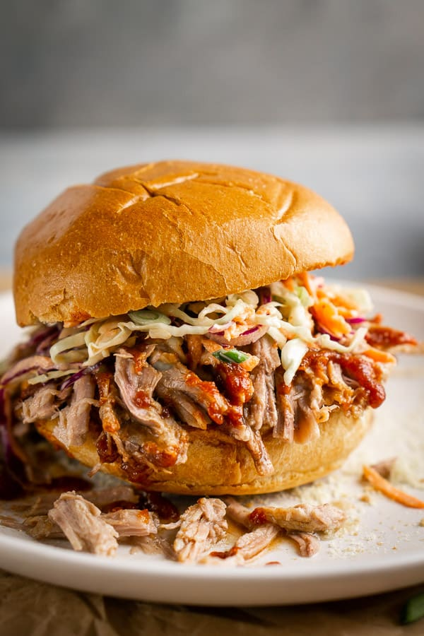 pulled pork sandwich with BBQ sauce and coleslaw on toasted bun