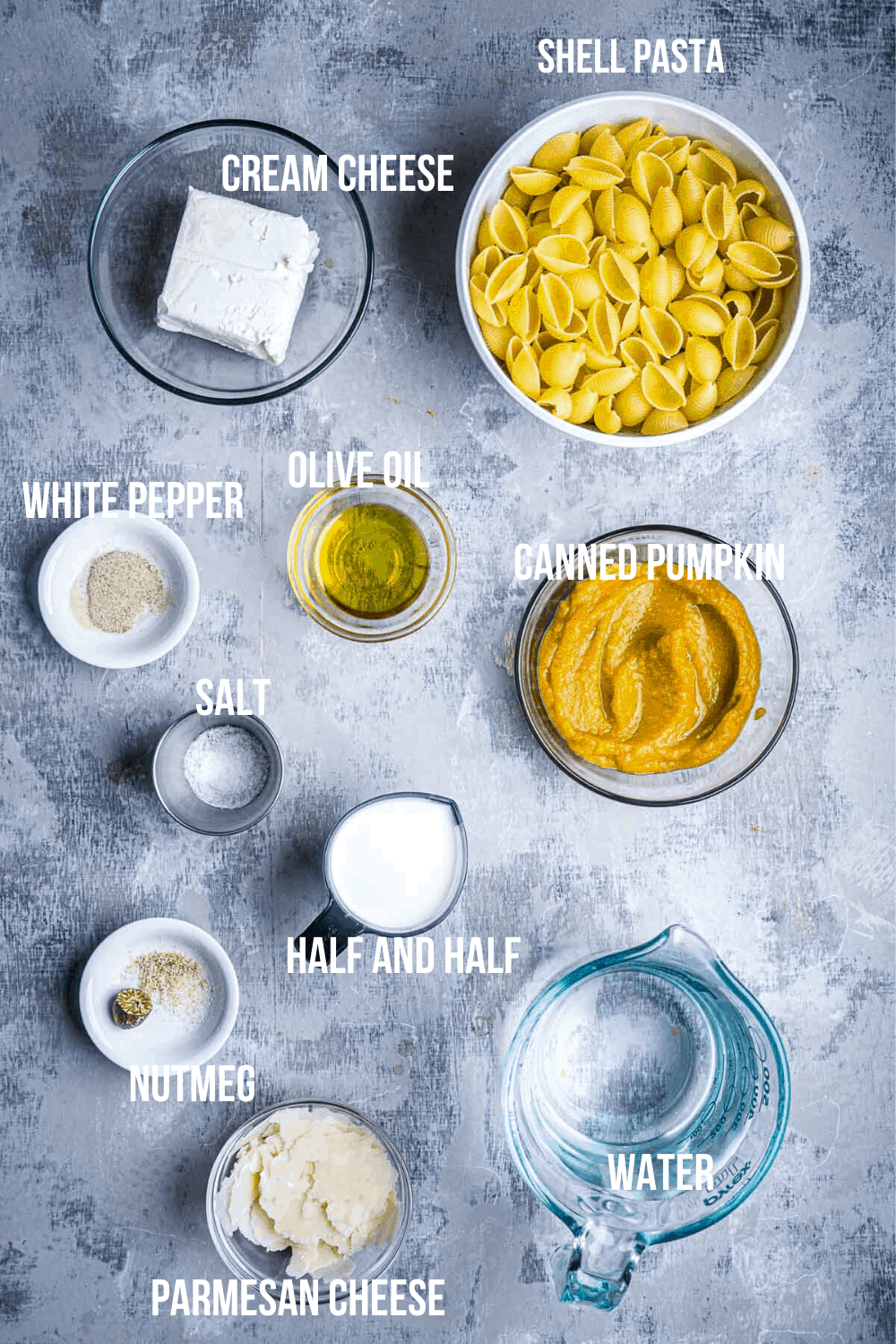 pumpkin pasta recipe ingredients in glass bowls with text overlay