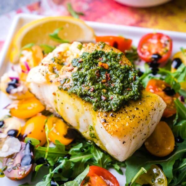 Chilean Seabass on arugula salad with Chimichurri topping