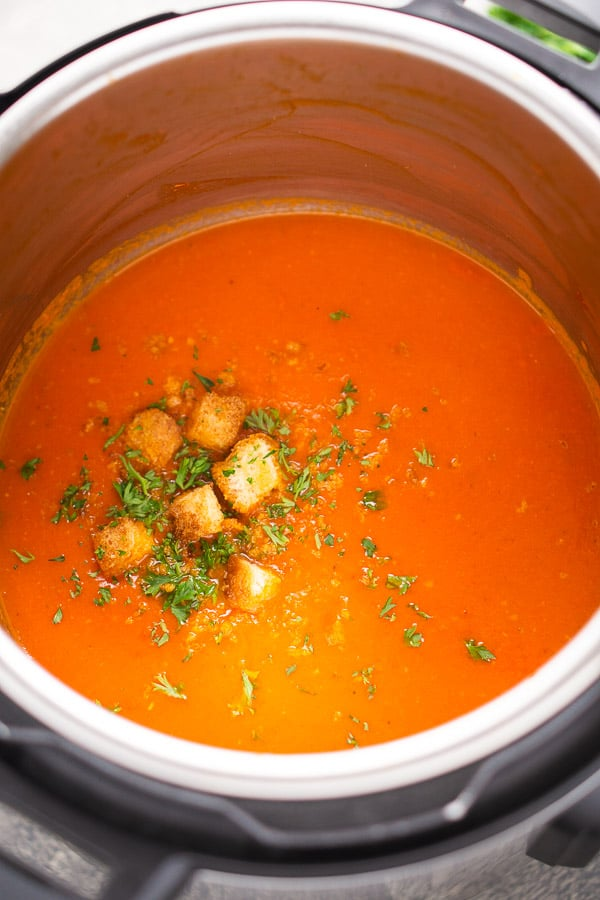 Tomato soup inside the Instant Pot topped with croutons and parsley