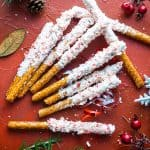 peppermint and white chocolate covered pretzels on Christmas background